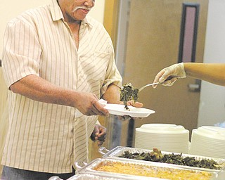 Walter Allen of Youngstown was among the people who enjoyed a Thanksgiving dinner Thursday at New Bethel Baptist Church. The church also delivered two hundred meals to homes and motels.
