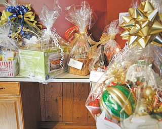 These baskets will be part of a silent auction and spaghetti dinner to benefit the Cook family of Struthers, whose 14-year-old son, Ty, recently had a brain tumor removed. The dinner will be Dec. 1 at St. Nicholas Great Hall on Fifth Street in Struthers.