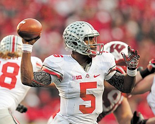 Ohio State quarterback Braxton Miller throws a pass against Wisconsin during the first half of a game in