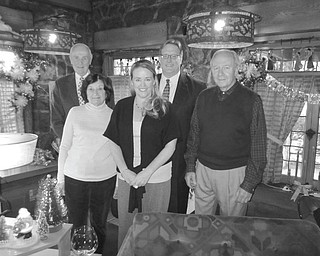 Members of the board of directors of the Mahoning Valley Historical Society preparing to welcome visitors to the fifth annual Memories of Christmas Past exhibit at the Arms Family Musuem, which opens Saturday, are, from left Dr. William J. Cleary, Marilyn Oyer, Tricia Perry, Bill Lawson, MVHS executive director, and Bob Calcagni. Exhibit hours are 1 to 5 p.m. Tuesday through Sunday. Admission is $6 for adults, $5 for seniors and $4 for children. A preview party will be from 5 to 7 p.m. Friday. Cost is $16 for members and $20 for guests. Reservations can be made by calling 330-743-2589.