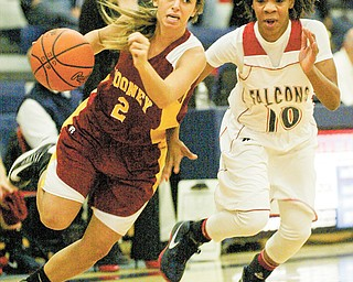 Mooney's Jamie DiDomenico (2) drives around Brenda Thompson (10) of Fitch during first half action Monday at Fitch. The Falcons ran past the Cardinals, 63-37, in the first game of the season for both teams.