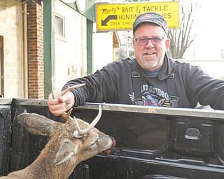 James Govenor of Cortland shows his buck that he bagged Monday morning on the opening day of the deer-gun season in Ohio.