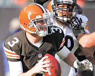 Cleveland Browns quarterback Brandon Weeden (3) is chased by Pittsburgh Steelers defensive end Brett Keisel (99) during last Sunday's game. Weeden's helmet struck the knee of teammate Joe Thomas during the game and the quarterback left the game with a concussion.