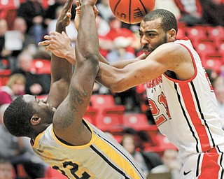 Youngstown State's Damian Eargle (21) collides with Kent State's Melvin Tabb (32) during the first half of a game at Beeghly Center on Wednesday night. The Golden Flashes defeated the Penguins, 85-78, in overtime.