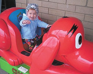 Brynni loves Clifford the big red dog! Submitted by Grandma Debbie Horvath.
