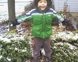 Timmy Kerr, 5, of Poland, thinks happiness is the first snow of the year. Photo taken by dad Gary Kerr.