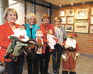 The Holiday Hopes and Wishes committee  prepares for the Dec. 14 luncheon, bake shoppe and basket raffle to benefit Akron Children's Hospital Mahoningn Valley at Mr. Anthony's in Boardman. From left are Dynna Hayat, Betty Cmil, Julie Costas and Kathy Dwinnells. PHOTO BY: ROBERT K. YOSAY  | THE VINDICATOR