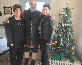 "Sharon Houser, left, Ray O'Neill and Susan George tour the Barnhisel Home during a recent open house weekend. O'Neill served as a costumed guide. Open houses are 1 to 5 p.m. today, Sunday, and Dec. 8 and 9. The theme is ""Christmas Trees Through the Ages"" with decorated trees using ornaments from late 1800s to 1960s. Among them are a feather tree, aluminum tree, nature tree, Coka Cola tree, Victorian trees and an old economy tree with 3-D paper ornaments. Refreshments and music will be provided as well as guides in period dress. Calendars for 2013 and note cards will be available for purchase. Donations are welcome. For information visit www.girardhistoricalsociety.org."