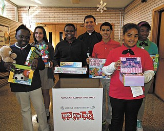 The Rev. Michael Swierz, president of Youngstown St. Joseph the Provider School, and the school's Student Council members are spearheading a collection of new, unwrapped toys for the Marine Corps Toys for Tots program. Donations are being accepted at the school, 1125 Turin Ave., until Wednesday. For information call 330-259-0353.