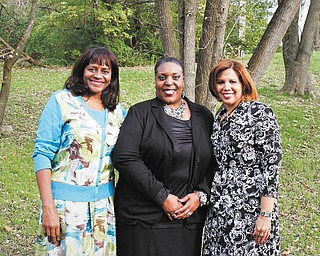Among the members of the Junior Civic League of Youngstown who were involved in planning the league's 57th annual Cinderella Ball were, from left, Sylvia Rupert, ball chairman; Cynthia Mason, public relations chairman; and Susan Moorer, league president. Photo by MADELYN P. HASTINGS | THE VINDICATOR