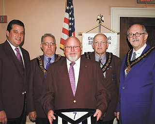 At a recent ceremony at the Masonic Temple in Youngstown, Dale E. Hawkins was installed as the Seventh Arch Adjutant for the Grand Council of Royal and Select Masons of Ohio. He will assist in promoting activities of the Grand Council with the local councils. He served the local council and is a past president of the Seventh Arch Association. Pictured from left to right are Dominic M. Lucarelli, Illustrious Master of Buechner Council 107; David G. Weimer, Seventh Arch Inspector; Hawkins; Robert K. Rhinehart, Deputy Grand Master; and James B. Parker IV, past Grand Master.