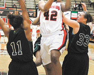 Youngstown State's Brandi Brown (42) shoots while Wilmington's Courtney Tucker (11) and Emily Zimmerman (33) try to defend during Sunday's game at Beeghly Center. The Penguins rolled, 83-52.