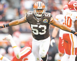 Cleveland Browns linebacker Craig Robertson (53) celebrates after making a tackle against the Kansas City Chiefs during an NFL game in Cleveland on Sunday. The Browns won 30-7.