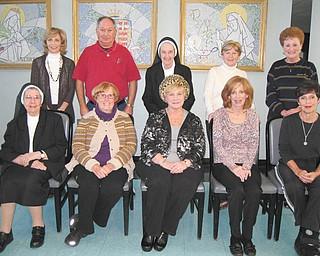 The Valentine's Day Dinner committee at the Ursuline Center, 4280 Shields Road, Canfield, is planning the sixth annual event for 6:30 p.m. Feb. 14 in the center's auditorium. Committee members seated are Sister Francis Marie Sopko, left, Eileen Novotny, Maggie Wellington, Sue Ricciutti and Peggy Eicher. Those standing are Joan Sonnett, left, Ray Novotny, Sister Jeanne Cigolle, Betty Clarke and Mary Yvo Assion. Tickets will be $25 and will include appetizers, entree, dessert, wine bar and entertainment. Canfield's Broad Street Diner will cater. Proceeds will benefit the ministries of the Ursuline Sisters of Youngstown. For tickets or information, call Peggy Eicher at 330-717-6806.