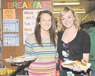 Springfield High School seniors Alexa Packard, left, and Erinn Coe serve breakfast Thursday to senior citizens during an annual National Honor Society service project.