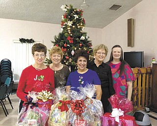 "Niles S.C.O.P.E. Senior Center Happy Tappers are selling raffle tickets for holiday baskets. Happy Tappers include Barb Freeman, left, of McDonald; Donna Crean of Warren; Vera Milijons of Niles; Norma Sauceman of Girard; and Peggy Peters of Warren. Proceeds will benefit the show ""Dancing for Others"" Jan. 26 at Packard Music Hall under the direction of Crean. Doors open at 4:30 p.m., and the show will start at 6. Tickets are $5. All proceeds will be given to needy local individuals to assist with medical bills. For information call the center at 330-544-3676."