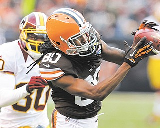 Cleveland Browns wide receiver Travis Benjamin (80) catches a pass in front of Washington Redskins cornerback DJ Johnson (30) and goes 69 yards for a touchdown in the fourth quarter of a game on Sunday in Cleveland. The Browns fell to the Redskins, 38-21.