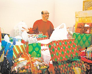 Tony Lape, a member of St. Patrick Church in Youngstown, expresses gratitude for all the Christmas gifts earmarked for children of inmates. He coordinates the Angel Tree ministry that has been at St. Patrick for about a dozen years.