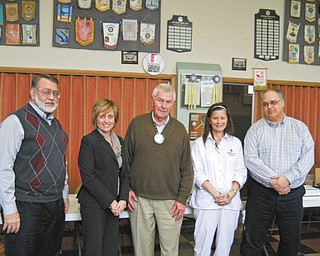 Struthers Rotary member Dan Becker, third from left, and Rotary president Tom Baringer, right, are shown with new members, from left, Drew Hirt, Lisa Daprile and Terri Sebastiano. Daprile is a certified public accountant with Beckwith, Daprile and Co. and is vice president of Maplecrest Nursing and Rehabilitation Center, which she has owned and operated with her husband Chris since 1997. Sebastiano has been director of nursing at Maplecrest for 13 years and also is an instructor of nursing at Choffin Career Center and Trumbul Career and Technical Center. Hirt is president, senior scientist and co-founder with his wife, Carol Jean, of Materials Research Laboratories Inc.