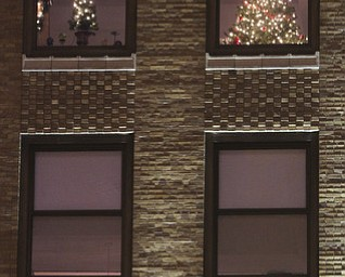 William d LEwis The Vindicator  Christmas tree in window of Realty Tower.