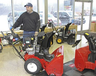 William D LEwis The vindicator  With asnowstorm raging outdours Dante Terzingni, owner of Do Cut in Boardman looks over his stock of snow blowers By 1:30pm Wed he said the store sold 40 snow blowers.