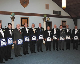 At a recent meeting of Canfield Argus Lodge, Past Masters assembled to receive the Grand Master of Masons of Ohio, James F. Easterling Jr. From left with year as master of the lodge are Thomas J. Haliden, 2001 and 2012; R. Christopher Gillam, 2010; George E. Brainard, 2007; Russell W. Gillam III, 1996; Mark D. Stovall, 1990; Gregory B. Anstrom, 1986; Donald L. Huntley, 1985; Eric Cahalin, 1983; Elmer J. Stalnaker Jr., 1981; Russell W. Gillam Jr., 1979; Emanual J. Cominos, 1974; and Dale E. Hawkins, 2003.