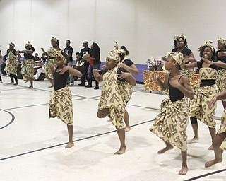 William D Leiws the Vindicator  Harambee dancers perform an African folk dance during Kwanzaa celebrationTuesday at McGuffey Centre.