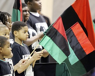 William D Lewis the Vindicator Tyler Wagner,11, holds an african flag during Kwanzaa celebration Tuesday at McGuffey Centre.