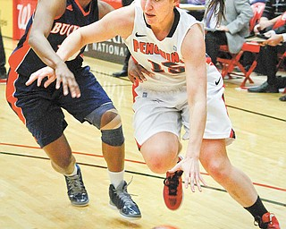 "Youngstown State's Heidi Schlegel (15) drives down the court against Bucknell's Sheaira Jones during Saturday's home game. Since returning from a concussion to start the season, Schlegel (aka ""the team's second-leading scorer and rebounder"") has come off the bench in the last nine games, fueling a Penguins team that no longer runs out of gas at the end of games."