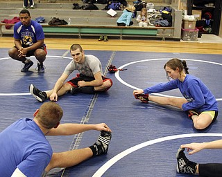 William D Lewis the Vindicator Hubbard sophomre wrestler Shirley Flynn warms up before a recent practice.  She is one of just a few girl wrestlers in the state.