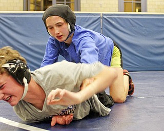 William D Lewis the Vindicator Hubbard sophomore wrestler Shirley Flynn  wrestles C.J. Latronico, a Hubbard freshman in the 106 pound class during a recent practice.  She is one of just a few girl wrestlers in the state.