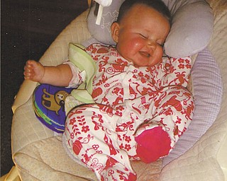 Grandma Marilyn caught her granddaughter Alexis smiling in her sleep She says it represents her resolution of getting more shut eye this year!