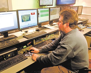 Mark Koontz, chief meteorologist for 21 WFMJ-TV, works on a forecast at the station. Koontz is retiring, and his final weather report will be today.