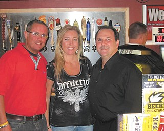 Austintown Trustees recently participated in a Celebrity Bartending fundraiser at Buffalo Wild Wings in Austintown. The trustees raised more than $350 in tips in two hours as bartenders. Shown from left are trustees Jim Davis and Lisa Oles and newly elected Mahoning County Commissioner David Ditzler. Other elected officials who participated were Jerry Green, Mahoning County sheriff; Mike Sciortino, Mahoning County auditor; and John McNally, Mahoning County commissioner. Proceeds will benefit 75 Austintown families in need, and one family will receive a shopping spree at Walmart.