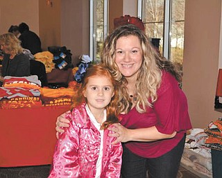 Above, Addison Miller, a kindergarten student at Holy Family Parish in Poland, and her mom, Jacci Miller, search for the perfect gifts at a recent Santa's Workshop at the center. Jacci also was one of the coordinators of this year's workshop. Below, Gianna Bindas, also a kindergarten student at Holy Family, and her father, Tom Bindas, also shop at the workshop.
