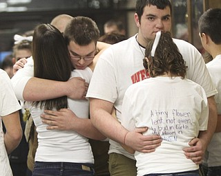 William D. Lewis the Vindicator  Wilmington HS students embrace before Sat.1-5-13 basketball game at their school. A classmate was killed friday in a traffic accident. They are from left Alexa Bretz, 10th grade, Ethan Seeber, 11th grade, Dakota Boyle, 10th grade and Emily reed, 10th grade.