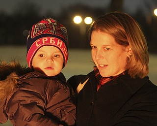 William D Leewis The Vindicator  Lisa Milosevic holds her son Luka, 2, as the watch burning of the yule log during Christmas eve service Sunday 1-7-12 at Holy Trinity Serbian Orthodox Church in Youngstown.