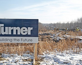 A sign marks land being cleared by Turner Construction Co. for the Austintown racino, slated to be finished in 2014. Though Penn National Gaming Inc., owners of the property, can clear the land, construction is being held up by approval of a transfer of license from the Ohio Racing Commission.