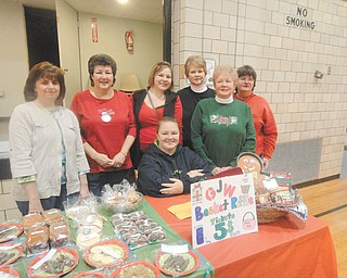 The annual Christmas bazaar sponsored by Girard Junior Women raises funds to benefit the community. Among members who worked on this year's fundraiser are, from left, Lynn Nastase, Laura Sobnosky, Kathy Fricker, Kathy Rossell, Martha Altier and Roberta Lawrentz, and seated, Bree Quesenberry. The women's group recently made donations to Emmanuel Community Care Center, Girard High School scholarships and robotics and community beautification.