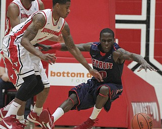 William D Lewis the Vindicator  YSU's Shawn Amiker(4) and Detroit's Jason Calliste(10) during 1rst half action Thursday 1-9-13 at YSU.