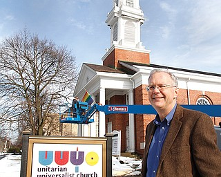 Matt Alspaugh, minister  with the leaning steeple..The First Unitarian Universalist Church of Youngstown, on elm  has decided to remove its steeple, which has fallen into disrepair, and store it at CASTLO Industrial Park pending possible restoration or replacement.