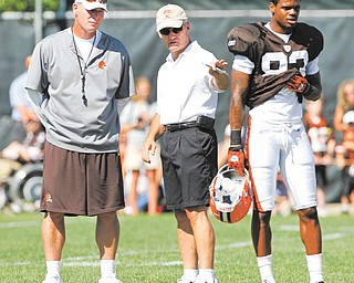 Former Ohio State head football coach Jim Tressel talks with then Cleveland Browns coach Pat Shurmur during training camp. At this point, Tressel's name has not officially come up as a candidate to replace the fired Shurmer.