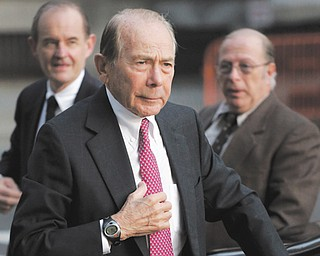 Maurice Greenberg, former CEO of AIG, arrives for a meeting of the insurance company's board of directors Wednesday in New York. AIG decided Wednesday not to join a lawsuit against the government that spent $182 billion to save it from collapse.