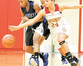 Youngstown Christian's Kayla Rios (14) and Cardinal Mooney's Brie Ozenghar (24) chase a loose ball during the first half of a game Monday night. Youngstown Christian won, 39-35.