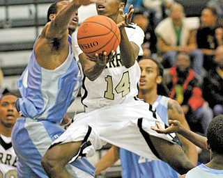 Warren Harding's King Garner (14) goes for a layup during the Raiders' game against East on Tuesday at Warren.