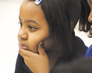 Makayla Mawyena, a student at Williamson Elementary School, in Youngstown listens during a program about Dr. Martin Luther King Jr. on Wednesday at the school.