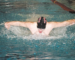Canfield sophomore Connor Brady competes Wednesday in the 200-meter butterfly relay during a swim meet against Alliance at the YSU natatorium. The boys remain undefeated, with Brady poised to make a return to state competition.