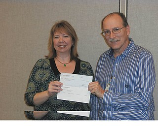 Deluxe Corp. Foundation awarded the YWCA of Youngstown a $5,000 grant to support its transitional housing program, which was established in 1991 and provides shelter to more than 25 individuals. Supportive services are also offered. YWCA of Youngstown has been involved in the development and management of housing for homeless and marginalized women since 1904. Other program areas include early care and education, youth development, health education and empowerment programs. Paul Brown, human resources facility manager of Deluxe, is shown giving the check to Leah Brooks, executive director of the YWCA of Youngstown.