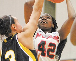 Youngstown State's Brandi Brown (42) puts up a shot against Wisconsin-Milwaukee's Emily Decorah (3) during the first half of Thursday's game at YSU's Beeghly Center. Brown posted 18 points in the Penguins' 67-50 win over the Panthers.