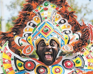 A carnival dancer performs at the annual Martin Luther King Jr. Day parade in Miami on Monday. Events honoring the slain civil-rights leader took place across the country.